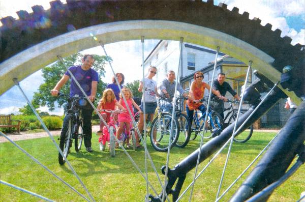 Shot of cyclists through a bike wheel